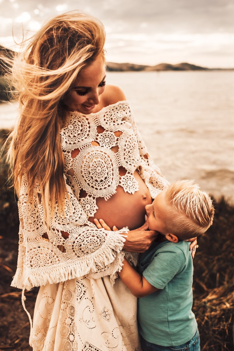 Bay Area Maternity Photography, little boy kissing mother's belly