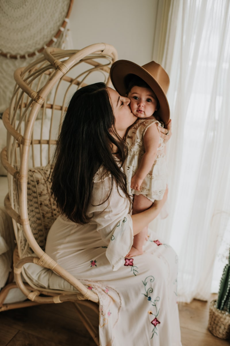 Bay Area Family Photography, mother sitting in a chair and kissing toddler on cheek