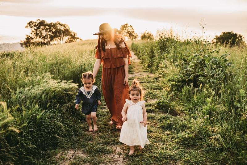 Bay Area Family Photography, mother and two kids walking down a grass pathway