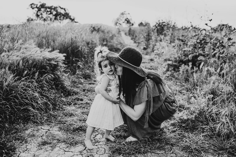 Bay Area Family Photography, black and white of mother kissing daughter on the cheek