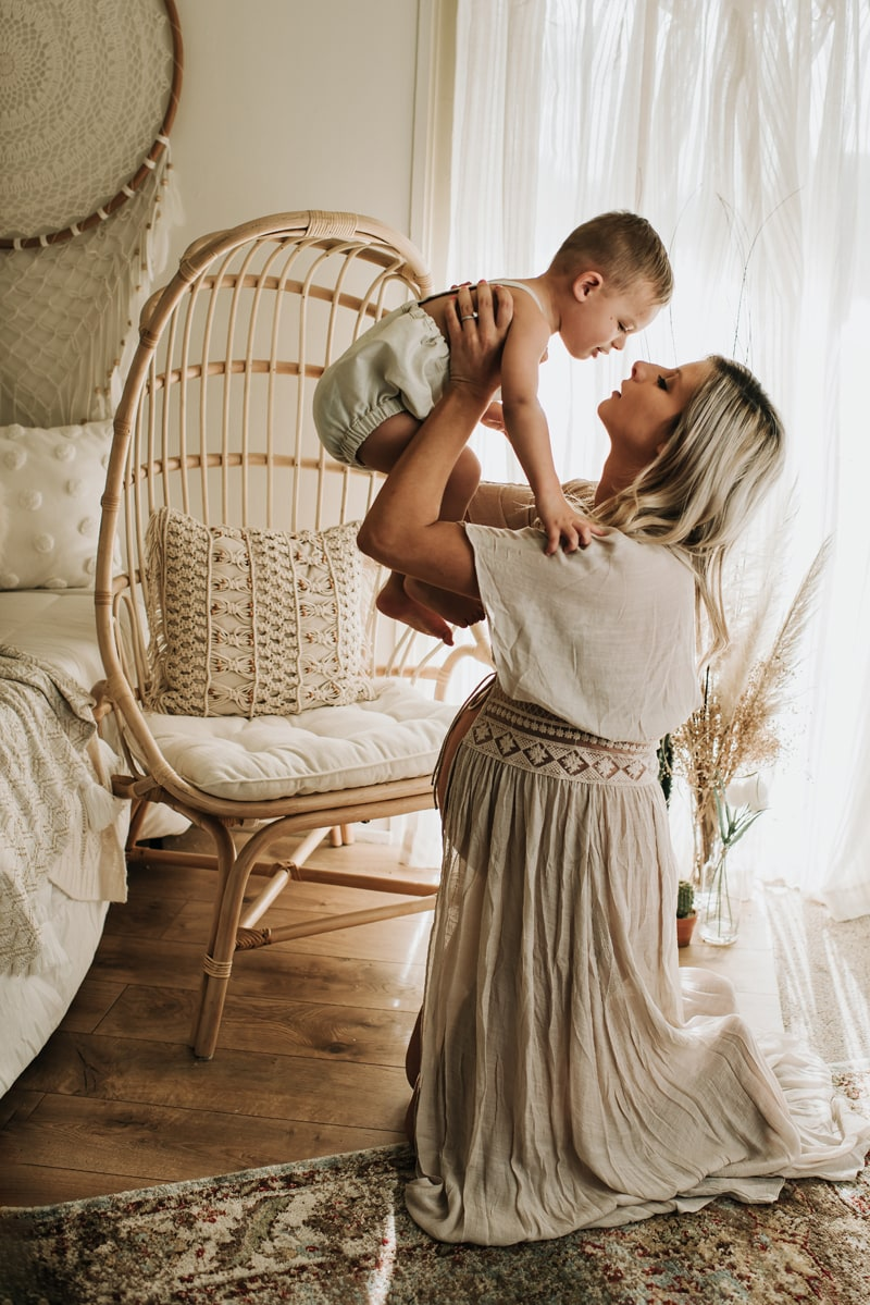 Bay Area Maternity Photography, mother hold baby above her head for a kiss