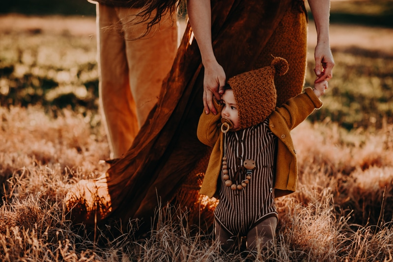 Bay Area Family Photography, family of three walking little toddler through a field