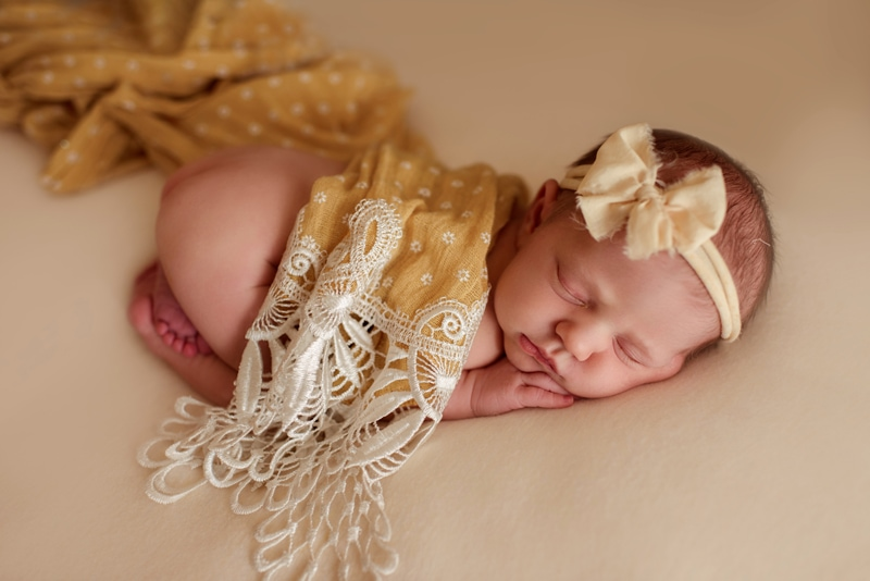Bay Area Newborn Photography, baby asleep on white background with white headband bow on
