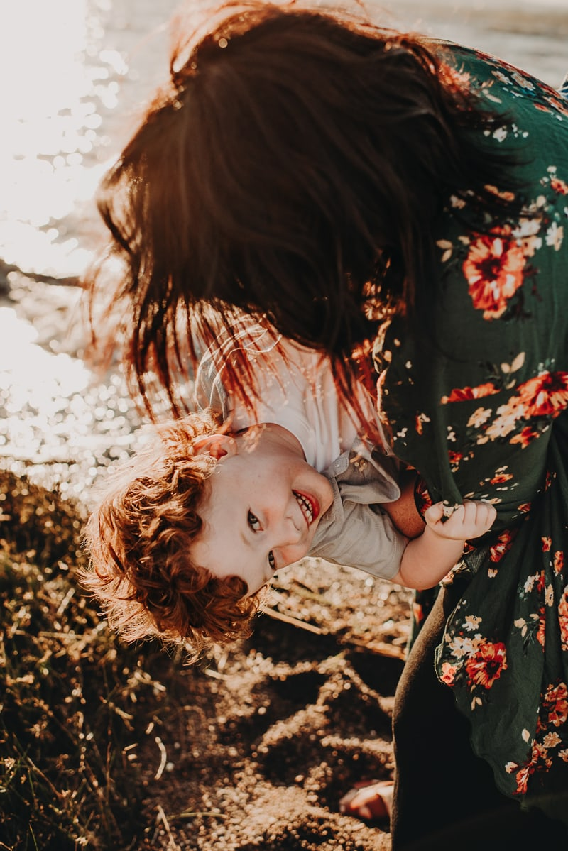 Bay Area Family Photography, mother dipping son toward the ground and laughing