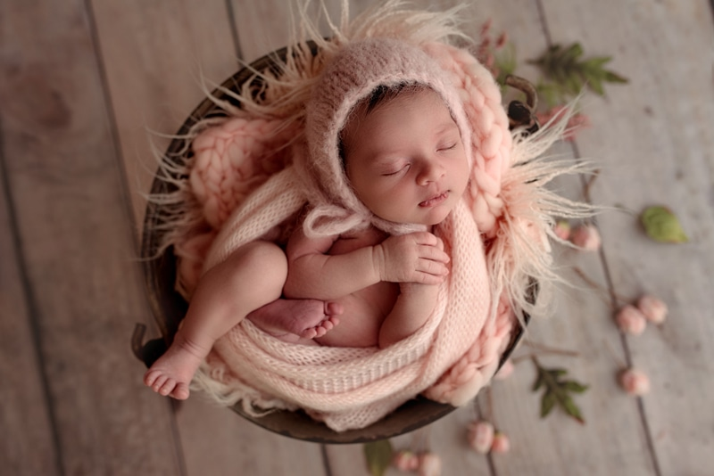Bay Area Newborn Photography, baby wrapped up asleep on pink blanket in basket