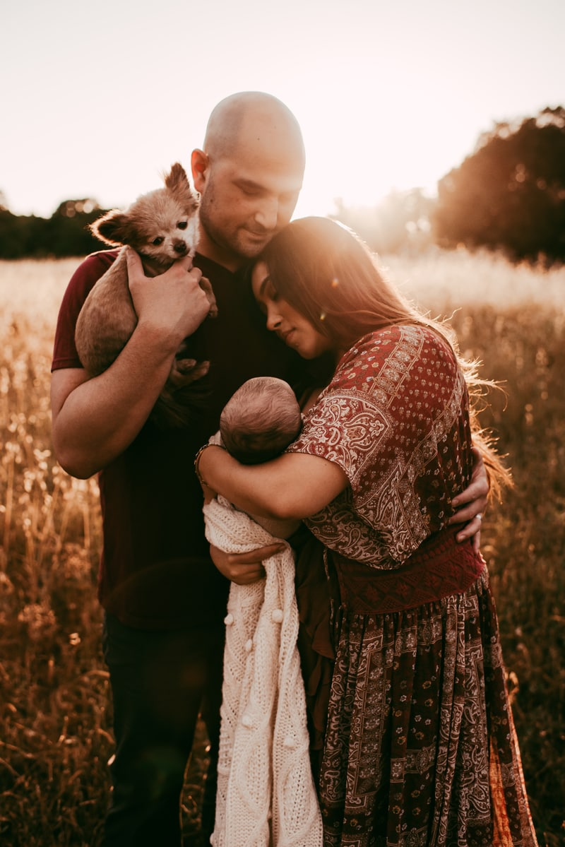 Bay Area Family Photography, couple holding new baby and family dog