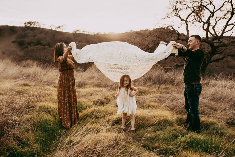 Bay Area Family Photography, family of three playing with a blanket