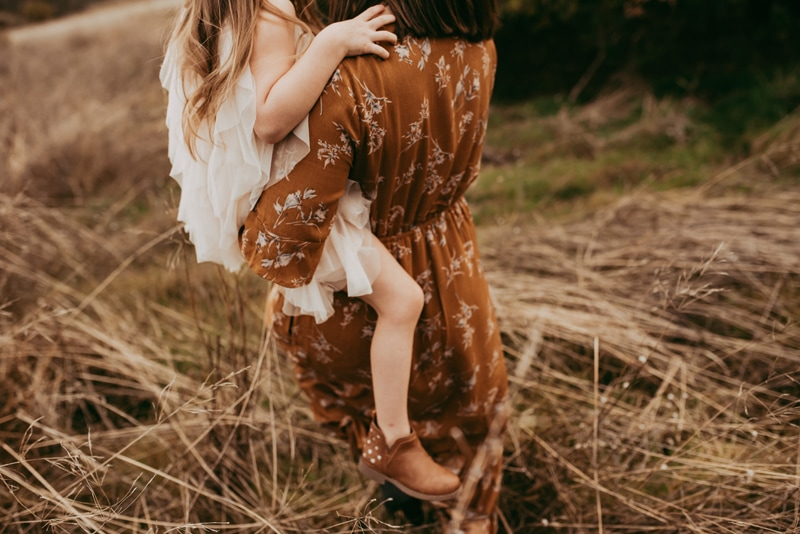 Bay Area Family Photography, mother and daughter walking through a field