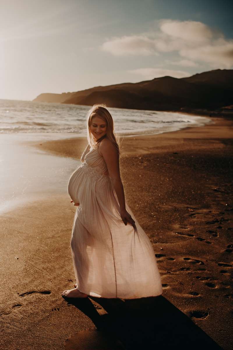 Bay Area Maternity Photography, woman walking around holding her dress out behind her