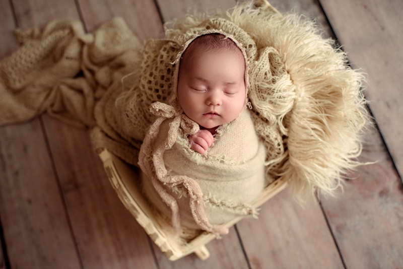 Bay Area Newborn Photography, baby wrapped up sitting in wooden basket