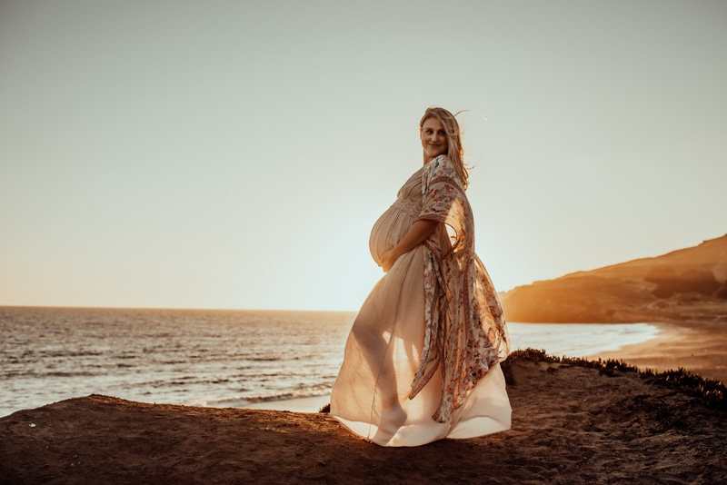 Bay Area Maternity Photography, mother in flowing dress with sunset in the background