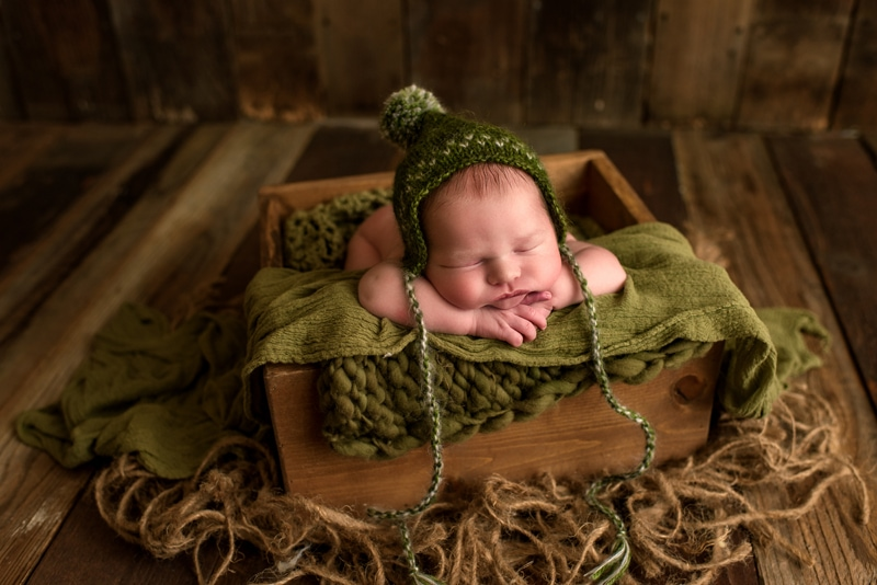 Bay Area Newborn Photography, baby in green bonnet in square basket