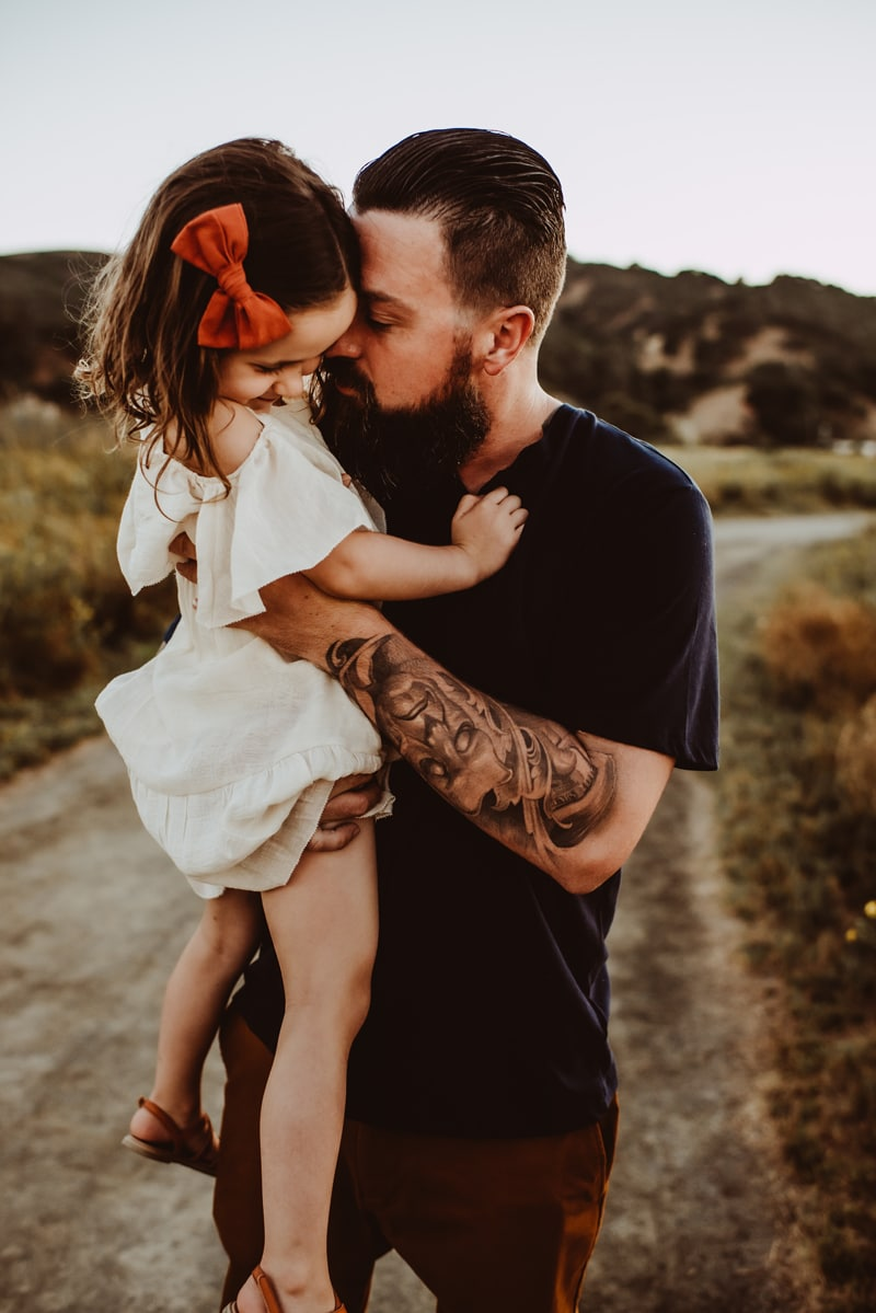 Bay Area Family Photography, father hold up his baby girl to his forehead